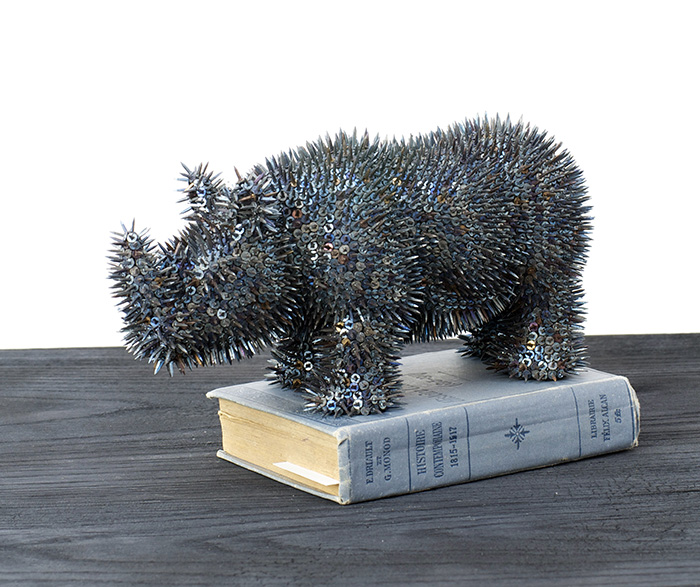 Harald Fernagu / Ménélik / Livre d'histoire, rhinocéros-objet de décoration africain, semences de tapissier - African decoration and upholstery tacks / 16 x 26,5 x 11,5 cm / 2019
