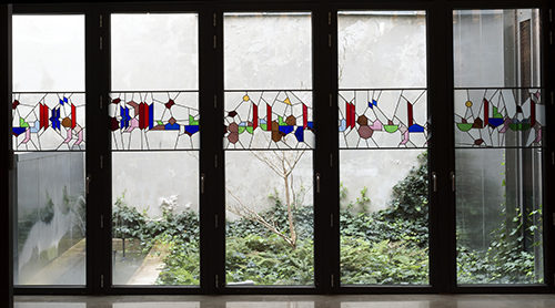 Sara Ouhaddou / You who travel with the wind, what weathervane shall direct your course?, extract from The Prophet by Khalil Gibran / Stained glass / Institut des Cultures d'Islam, Paris / 2017